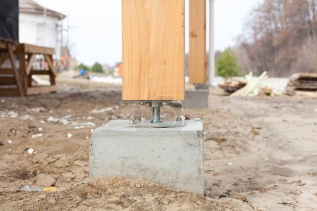 Wooden pillar on the construction site concrete with screw. Wooden Pillars are structures that can be placed on Foundations or Platforms