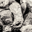 Pure tin ore, mined in south america....