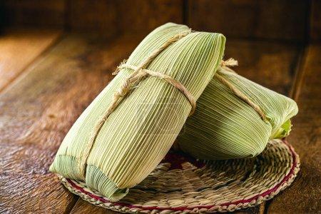 Pamonha, maïs typique sucré au fromage rural du Brésil, fermé dans la paille sèche, consommé en Juillet et Juin fêtes .