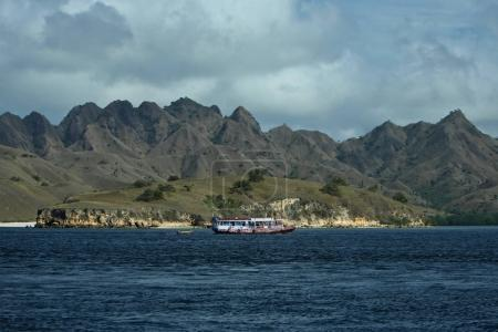 Mountains landscape with ship