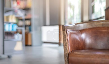 Photo for Selective focus of vintage leather chair in blurry coffee shop background for montage product design display - Royalty Free Image