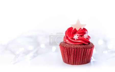 Photo for Red christmas cupcake for new year festivity on bright lights background use for greating card decoration - Royalty Free Image