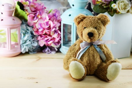 beautiful interior decoration teddy bear with different home related objects