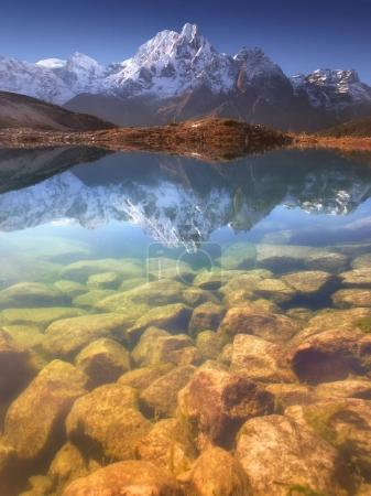 Photo for Nepal, Manaslu Region, a reflection in the Bimtang lake (3,680 m) of the Phungi peak (6,538 m) in the centre and the Mansiri Himal (7,059 m) at the left side. - Royalty Free Image