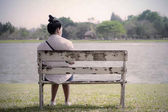 Beautiful lonely woman in frustrated depression sitting alone on