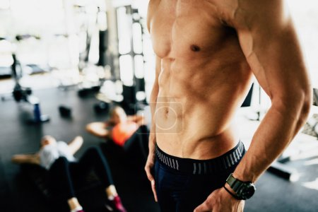 Attractive male torso in gym