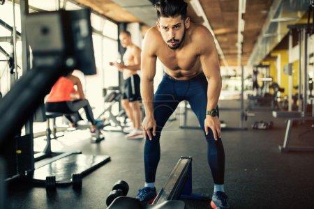 Determined bodybuilder in gym