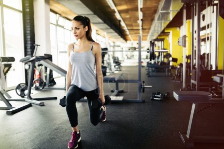 Beautiful woman working out in gym