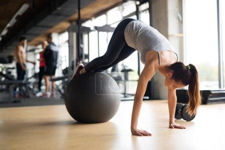 Beautiful woman training in gym