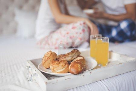 Romantic couple having breakfast in bed