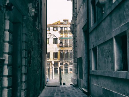 Photo for Narrow passage in Venice streets leading to water - Royalty Free Image