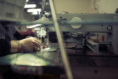 Worker in textile industry sewing