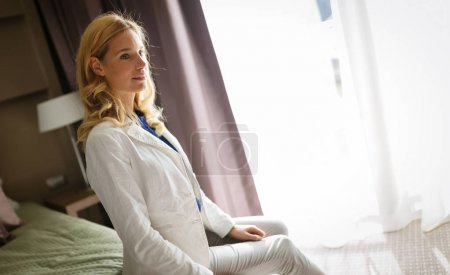 Blond woman in hotel room