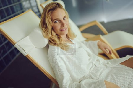 Beautiful woman relaxing in bathrobe