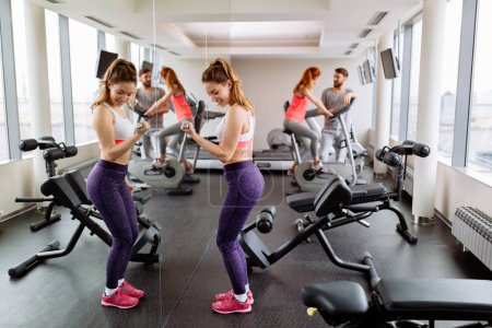 Photo for Fit beautiful  woman working out in gym - Royalty Free Image