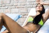 Beautiful brunette sunbathing