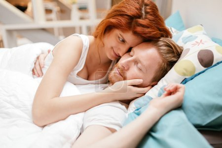 Romantic couple in love lying on bed