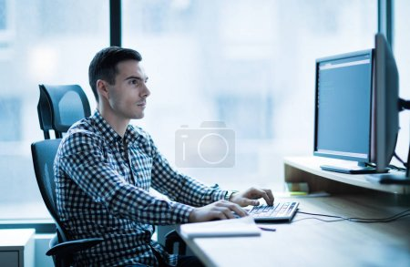 Professional software developer working in office