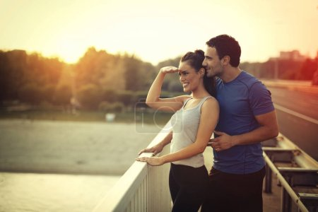 Photo for Athletic couple jogging together outdoors - Royalty Free Image