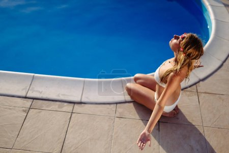 Woman sunbathing in summer in bikini