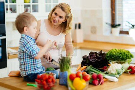 Photo for Mother and child preparing lunch from fresh veggies - Royalty Free Image