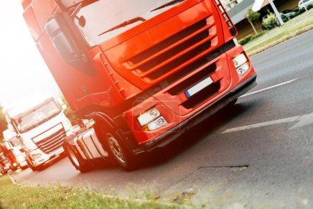 Trucks on road in row