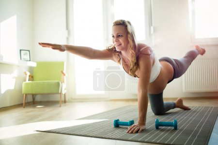 Pregnant woman practicing fitness