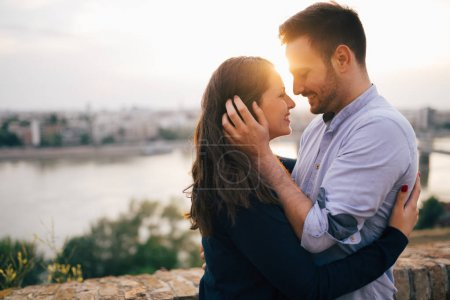 Photo for Romantic couple kissing during sunset - Royalty Free Image