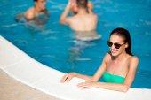beautiful woman enjoying pool