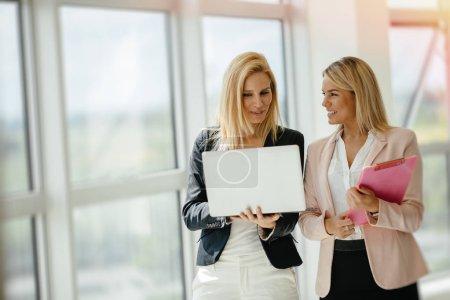 Businesswomen colleagues at work
