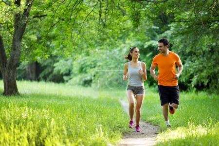 Happy couple running together