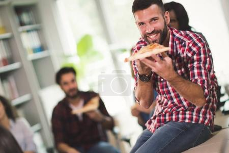 Coworkers eating pizza