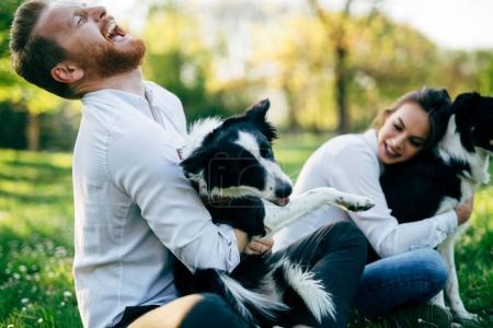 Beautiful couple walking dogs