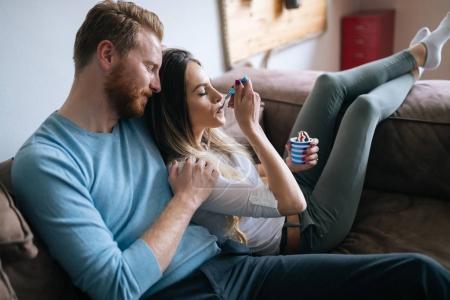 couple in love eating ice cream