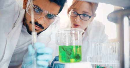 students of chemistry working in laboratory