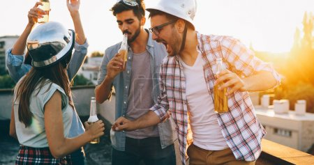 friends having party on rooftop