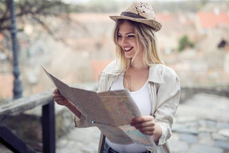 Happy female tourist sightseeing