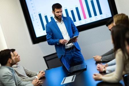 Picture of businesspeople attending to seminar in conference room