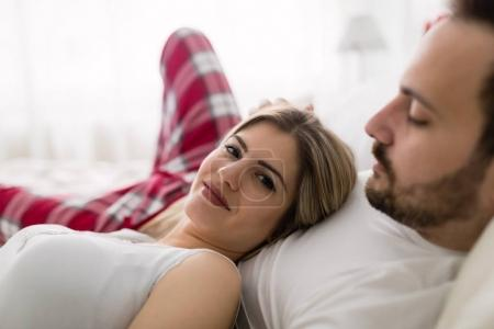 couple having romantic time in bed