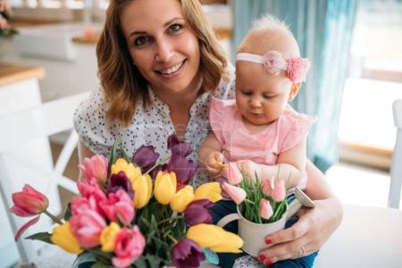 Child daughter congratulates moms