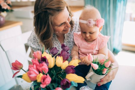 Happy mother and baby making decoration