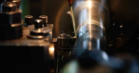 Finishing metal working on high precision grinding machine in factory