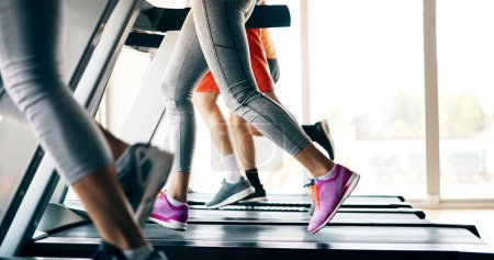 Photo for Picture of people doing cardio training on treadmill in gym - Royalty Free Image