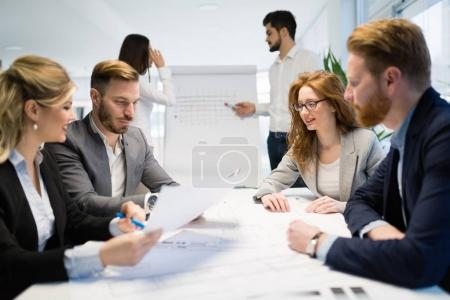 Photo for Business colleagues in conference meeting room during presentation - Royalty Free Image