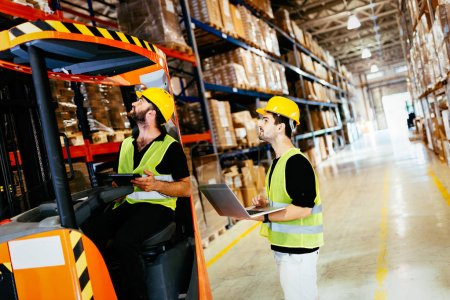Logistics people working in warehouse