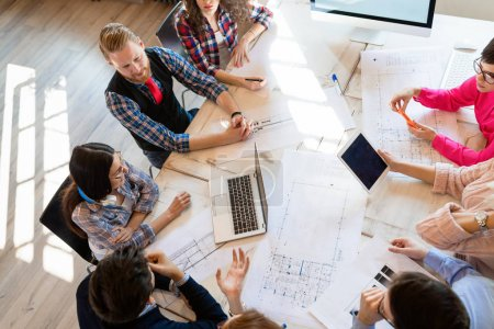 Group of architects and business people working together and brainstorming