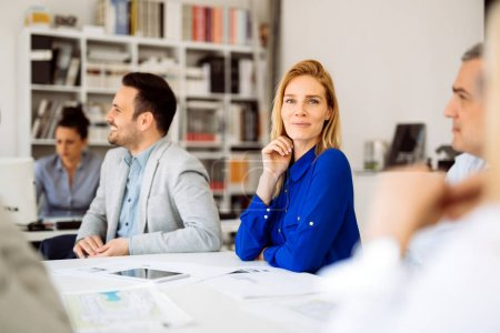 Successful young ceo businesswoman working with employees