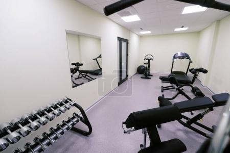 Small affordable home gym with fitness quipment