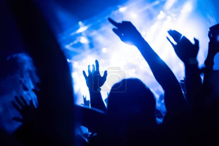 Photo for Picture of party dancing people at music festival - Royalty Free Image