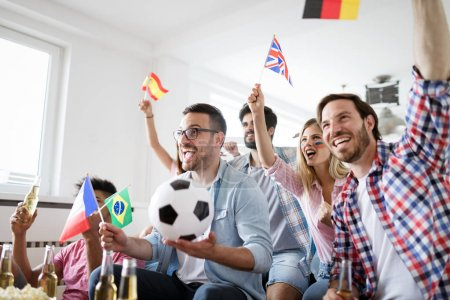 Excited and happy fans of soccer celebrating winning match